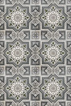 Moroccan inspired tile with shades of navy blue on genuine carrara, this patterned tile is meant for any bathroom floor or kitchen backsplash.