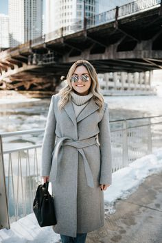 Chicago blogger Jessica Rose Sturdy wearing a Claudie Pierlot grey wool coat, Vineyard Vines grey cashmere sweater, and Rag & Bone boyfriend jeans with mirrored sunglasses and a Polene Paris satchel.