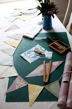 use discontinued wallpaper samples from the local paint store to use to make a bunting for party decorations