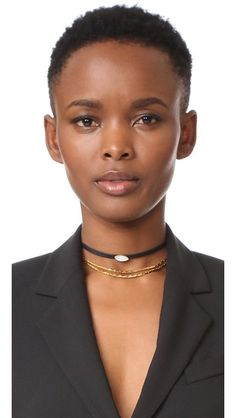 A double-strand Lacey Ryan choker made from gleaming snake chains. Adjustable length and lobster-claw clasp.