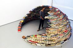 "Book igloo by Miler Lagos  ""This unique domed construction was built with volumes taken from the library of a defunct US Navy base."""