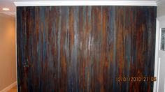 Rusty iron wall with blue patina.. Mad colors.