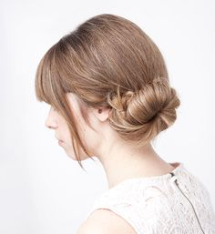This off-center bun involves little more than twisting and pinning up a ponytail, but the result is striking. And, notes the blogger, the style works particularly well with thick hair.