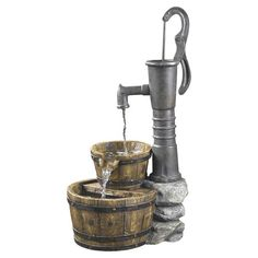 Rustic pump-style electric fountain with a tiered wooden basket basin.   Product: FountainConstruction Material: