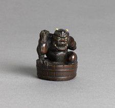 Wood netsuke of Oni Gyozui