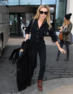 Abbey Clancy.. black attire with red cowboy boots..