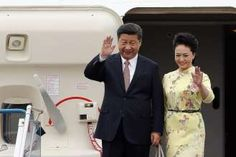 Chinese President Xi Jinping and his wife Peng Liyuan arriving in Hanoi yesterday. They are in Singapore today for a two-day visit.