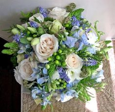 I like the roses and the white and green. It's the bluish flowers that are throwing me off. This really isn't my favorite, but it was listed as summer. Steven Bruce Design: Bouquet summer (Brides Eye View)