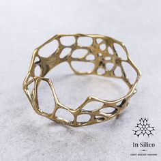 'Phenotype' bracelet. Bone structure inspiration, 3d printing, polished brass. More info on our site: insilico.pl #minimal #3dprint #jewelry #generativedesign #design #bracelet