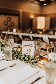 Gold calligraphy table number | Image by Baylee Dennis Photography #wedding #centerpieces #reception #weddingreceptioninspo #weddingreception #receptioninspiration #reception decor #finishingtouches #weddingdecor #tablescape #floraldesign