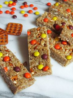 NO-BAKE PEANUT BUTTER GRANOLA BARS Ingredients: 1/4 cup unsalted butter 1/4 cup brown sugar 1/4 cup honey 1/4 cup creamy peanut butter 1 tsp vanilla extract 2 cups quick oats 1/2 cup crispy rice cereal 3/4 cup chopped pretzels 1/4 cup mini Reese's pieces Directions:  Cut out an 8 x 8 inch square of parchment paper. Place the parchment paper in the bottom of an 8 x 8 inch baking