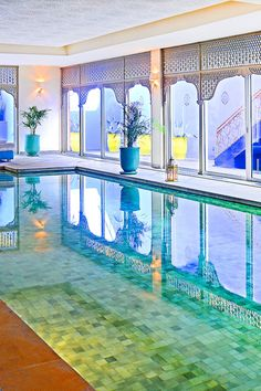 Sofitel Marrakech Lounge and Spa - Marrakech, Morocco - The chic indoor pool at the spa is surrounded by Moroccan lanterns and lounge beds.