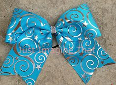 """3"""" Width Cheer Bow 7""""x6.5"""" Texas Size Carolina Blue Cheer Bow Turquoise Swirl and Star Silver Foil by JustImagineThatBows on Etsy"""