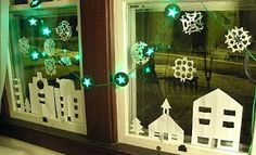 Simple white cut out winter village easy Christmas decorating with kids.