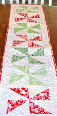 Quilt a Christmas pin wheel table runner! I would have a difficult time taking this off of my table after the holiday season.