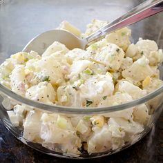 For the best potato salad, use low-starch potatoes, boil them in their skins, and drizzle vinegar both on the potatoes and in the dressing.