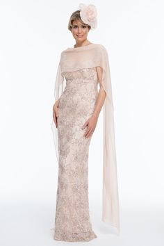 Beautiful and feminine floor length dress with all-over beading and embroidery. This dress has a sweetheart neckline and soft sheer cap sleeves to cover the shoulders.  The fun floral hat adds a quirky touch to this outfit.   All of our outfits are made to measure, and tailored to flatter your body shape and size.  …