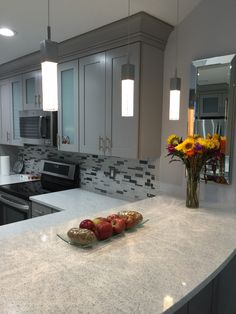 Cambria   Whitney Counters Kraftmaid   Pebble Grey Cabinet Stainless U0026  Glass Backsplash