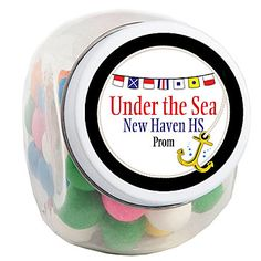 Our Nautical Candy Jars feature a variety of nautical signal flags and an anchor accent on a white background!