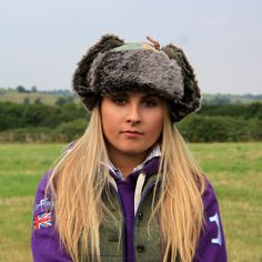 New for 2014 this fabulously trendy and deliciously warm Tweed patchwork Deerstalker trapper hat. It is made from the finest British Tweed in a selection of modern colours with its patchwork design making it funky and unique. It has a grey/black faux fur trim detail and is lined with a colourful and soft polar fleece..