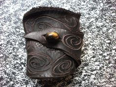 Brown Leather Wrist Cuff w/ Swirls. $20.00, via Etsy. Treadlight Gear