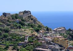 Castelmola a hilltop village above Taormina, crowned by a ruined castle. It offers eye popping views of the coastline and Mount Etna. You can get there by walking or take the Interbus service.