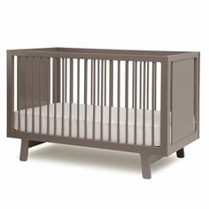 Oeuf Sparrow Collection Crib in Gray. Created by parents who appreciate modern design, the Sparrow crib's simple but classic looks are beautiful and versatile. The slim side rails give this crib a light, airy feel. Like European cribs, Oeuf uses fixed side rails to offer one of the sturdiest and safest cribs available. All Oeuf's cribs are made in Europe to strict environmental standards.