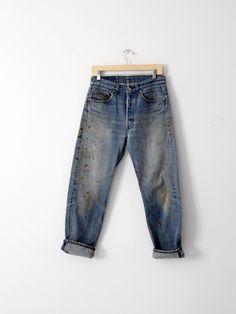 A pair of paint splatter vintage Levi's 501 jeans. The classic denim pants sit…