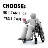A person sits in a wheelchair and presses a touchscreen to select the option Yes I Can, expressing a positive attitude stock photography