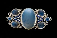 An Exquisite Moonstone & Sapphire Brooch attributed to Louis Comfort Tiffany.