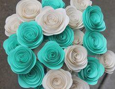 He encontrado este interesante anuncio de Etsy en https://www.etsy.com/es/listing/153904878/24-teal-cream-paper-flowers-wedding