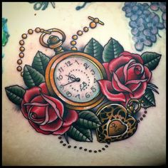 Beautiful memorial piece, pocketwatch and locket.  IG: shawnpattontattooer Cleveland, OH