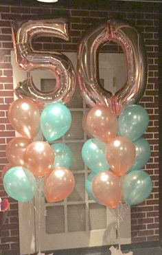 Rose Gold and Mint balloon bouquet for 50th birthday.