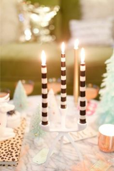 Striped Candles | http://burnettsboards.com/2013/12/stylish-christmas-wedding/