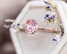 cushion engagement ring This new, dreamy ring features a Chatham peach sapphire and a hand engraved twig band. Ring details- -Main stone is an approximately peach chat Engagement Ring Settings, Solitaire Engagement, Peach Sapphire, Sapphire Stone, Dress Rings, Ring Verlobung, Thing 1, Princess Cut Diamonds, Engraved Rings