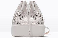 Spring's Coolest Bag Was Made For Practical Girls #refinery29  http://www.refinery29.com/best-bucket-bags#slide-1  Perforated designs are another popular bag trend; Zara is killing two birds with one stone.