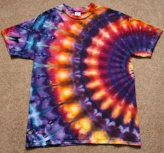 How to Tie-Dye Shirts 10 WaysEven very young kids can help make this cosmic design. For the best results, use a prewashed and dried 100 percent cotton T-shirt. Gather up some rubber bands and prepare Tye Dye, Tye And Dye, How To Tie Dye, Diy Tie Dye Projects, Tie Dye Crafts, Diy Crafts, Tie Die Shirts, Diy Tie Dye Shirts, Easy Diy Tie Dye