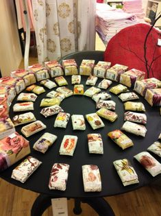Neat way to display soap on a round table. Could be placed in the middle of a craft fair booth so people can shop from all sides.