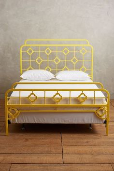 this was my old childhood bed i gave it a new flashy life by painting it bright yellow i used unmellow yellow in high gloss by behr the pillows - Yellow Bed Frame