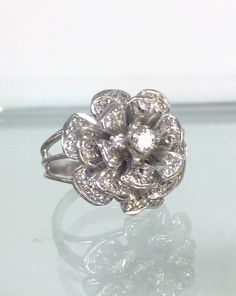 A personal favorite from my Etsy shop https://www.etsy.com/listing/235722085/one-of-a-kind14k-white-gold-diamond-rose