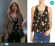 Haley's floral cross strap top  on Modern Family.  Outfit Details: https://wornontv.net/61890/ #ModernFamily