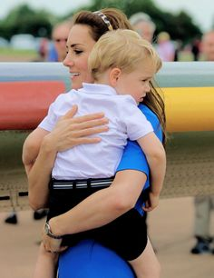 The Duke and Duchess of Cambridge and Prince George during a visit to the Royal International Air Tattoo at RAF Fairford on July 8, 2016 in Fairford, England.