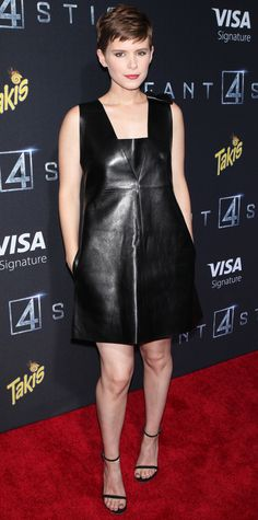 Kate Mara donned a bow-accented Valentino leather black dress that she styled with Jennifer Meyer earrings and delicate black sandals.