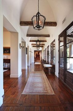 Wood accents, white walls, and windows that span from floor to ceiling are sure to make a statement in your home.