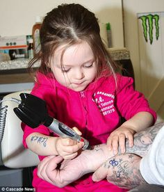 Three-year-old Ruby Dickinson is set to become the world's youngest tattoo artist after learning the trade from her father, Blane, who runs a tattoo parlour in Wales. Mr Dickinson, 36, is importing an ink gun from the U.S. that has been specially designed to be used by small hands.