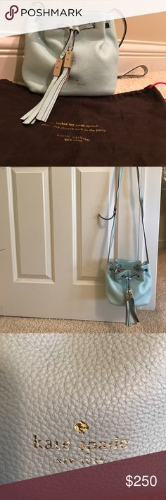 Kate Spade Leather Grace Blue Cross-body Purse BRAND NEW! REAL LEATHER! 14k light gold plated hardware!Was given to me as a gift and hasn't left the bag ever! This is a beautiful soft grace blue cross body bag with a drawstring. The interior is lined & has one pocket. The over sized tassels on the front give it a sassy edge that ever women wants on her purse! kate spade Bags Crossbody Bags