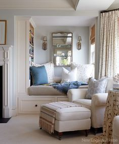 a cozy reading nook with lots of pillows & built-in bookshelves- for the living room, den or nursery