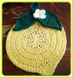 Cute Lemon Crocheted Trivet/Potholder. (Should make 2-like the Apple tutorial-and stitch them together. Much thicker and safer to use. Cotton yarn only, or some natural fiber.)