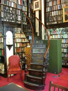 Home library with a hanging staircase.