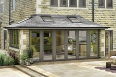 Grey Bi Fold Doors on an Everest Tiled Roof Extension